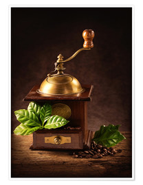 Premium-plakat Coffee mill with beans and green leaves and a cup of coffee